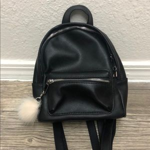 Topshop faux leather mini backpack with pompom